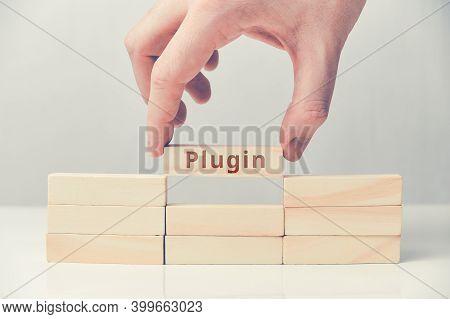Concept Plugin For Websites On Wooden Blocks.