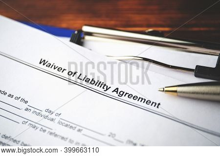 Legal Document Waiver Of Liability Agreement On Paper Close Up.