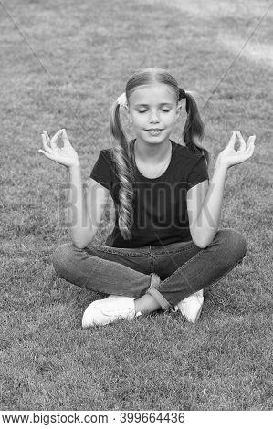 Meditation Practice. Little Child Do Meditation On Green Grass. Small Girl Sit In Mudra Position Dur