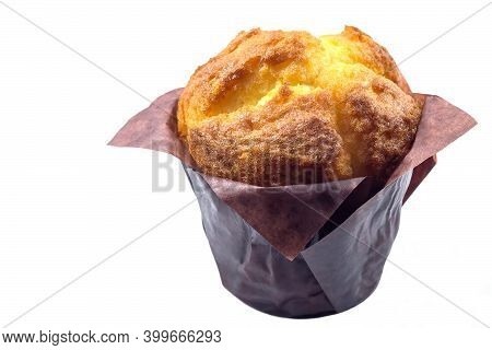 Fresh Appetizing Vanilla Muffin In Brown Paper On White Isolated Background.
