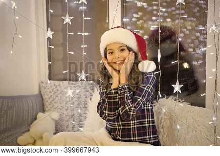 Turn On Garland For Magic Atmosphere. Illumination Concept. Happy Winter Holidays. Small Girl At Hom