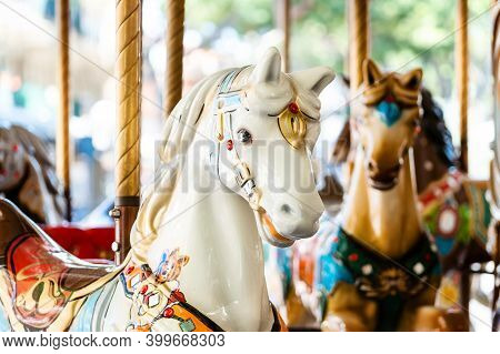 Vintage French Carousel Horse Closeup In Fair Park. Merry-go-round Horses In Amusement Fun Park For