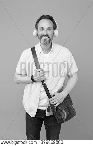 Get The Very Best Audio Experience. Bearded Man Listen To Music Grey Background. Mature Male Wear Au
