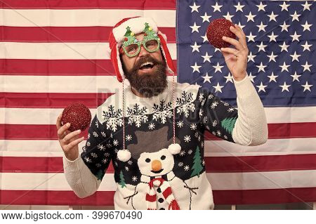 American Xmas. Happy Santa Hold Xmas Tree Balls. Bearded Man Celebrate Xmas. Holiday Decoration And