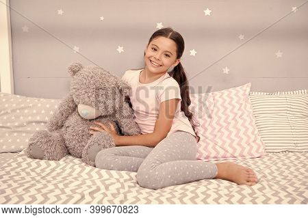 Imagination And Development. Happy Child Cuddle Teddy Bear In Bed. Little Girl Smile With Childhood