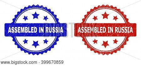 Rosette Assembled In Russia Watermarks. Flat Vector Scratched Seals With Assembled In Russia Text In