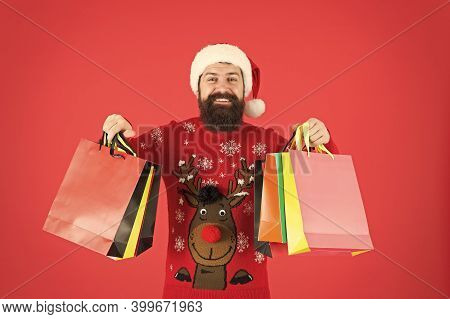 Keep Calm And Carry On. Bearded Man Hold Shopping Bags. Happy Hipster Carry Paper Bags. Holiday Purc