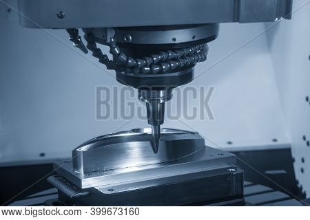 The 5 Axis Cnc Machining Center Cutting The Automotive Mold Parts With Solid Barrel End Mill Tools.
