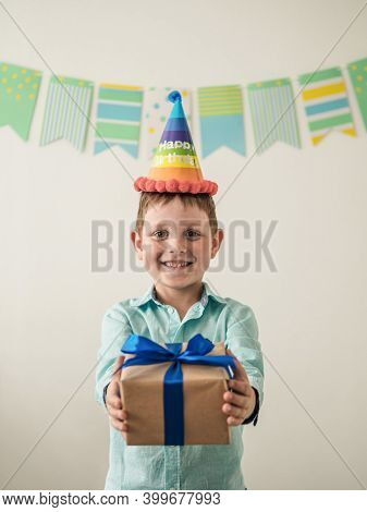 Five Year Old Boy In His Birthday Hold Gift Box. Happy Little Child Hold Gift Box With Present And L
