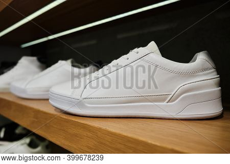 Blank White Casual Sneakers On The Shelf Of Footwear Store