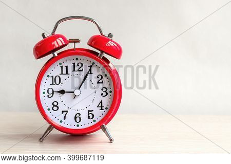 Close-up Of Red Metal Retro Alarm Clock That Show Nine O'clock. Concept Of Morning Or Evening Time A