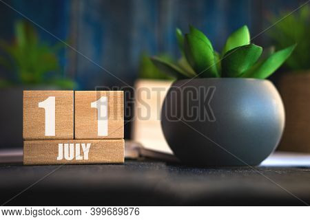 July 11th. Day 11 Of Month, Cube Calendar With Date And Pot With Succulent Placed On Table At Home S
