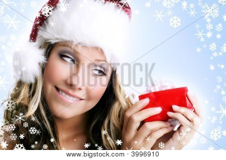 Woman With A Gift And Snowflakes