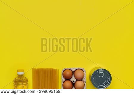 Set Of Products On Yellow Background, Flatlay, Top View-sunflower Oil, Chicken Eggs, Tray, Canned, P