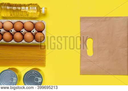 Set Of Products On Yellow Background With Paper Bag, Flatlay, Top View-sunflower Oil, Chicken Eggs,