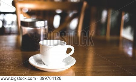 Hot Coffee Americano On The Old Wooden Table. A Cup Of Coffee On A Plate. Americano Black Coffee. Co