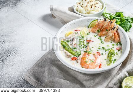 Tom Kha Gai. Creamy Coconut Soup With Chicken And Shrimp. Thai Food. Gray Background. Top View. Copy