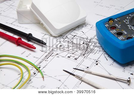 Electrical Instruments Laying On Blueprint