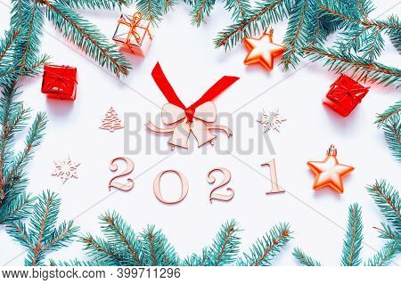 2021 New Year background with 2021 figures, Christmas toys and fir branches. Flat lay, top view of New Year 2021 still life, 2021 card, 2021 background, 2021 festive border, 2021 festive postcard