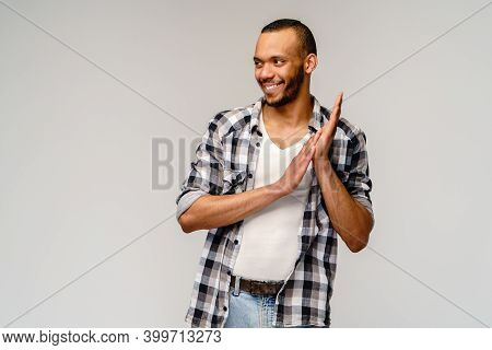 Closeup Portrait Of Happy Young Handsome African-american Man Rubbing Hands Together In Anticipation