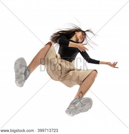 Dance. Young Stylish Woman In Modern Street Style Outfit Isolated On White Background, Shot From The