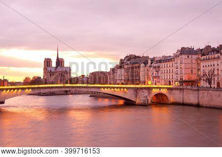 Apartments On Ile Saint Louis, Notre Dame Cathedral On Ile De La Cite And Pont De La Tournelle Bridg