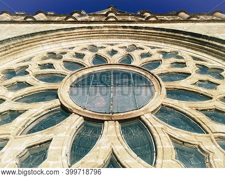 Gothic Rose Window Of The Cathedral Of Sevilla, Spain. View From The Outside. Exterior Faccade