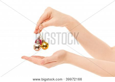 Woman's Hands With  New Year Toys Isolated