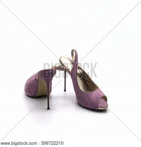 Women's Summer Open Shoes Made Of Lilac Suede. Thin High Stiletto Heel. The Lining Is Gold. Isolated