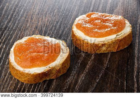 Two Sandwiches With Butter And Pollock Roe On Dark Wooden Table