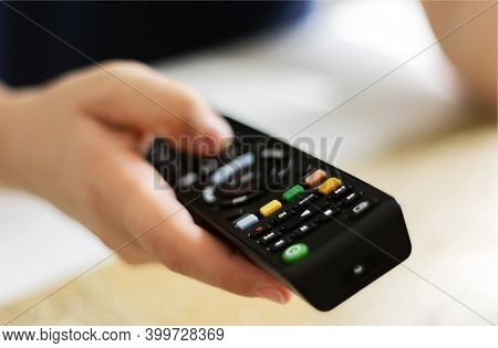 Caucasian Woman Hands Holding Television Remote Control. Selective Focus. Infrared Wireless Technolo