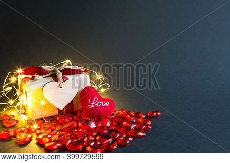 Red Glass Hearts And A Soft Plush Heart With The Words Love On A Black Background - Valentine\'s Day