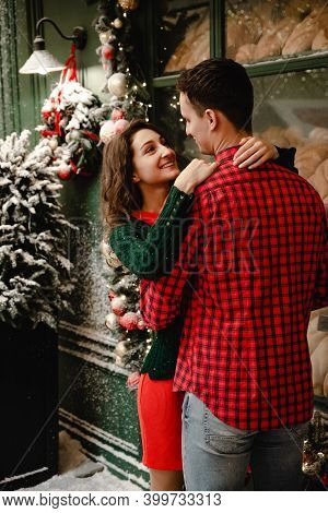 Christmas Lovers, Young Romantic Couple Having Fun Outdoors In The Winter Before Christmas. Enjoying