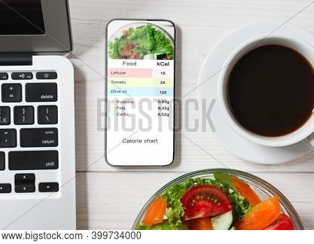 Calorie Counter Concept. Modern Smartphone With Opened Application For Counting Calories On Screen F
