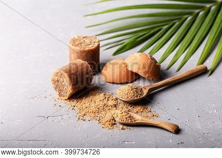 Different Shape Of Organic Brown Palm Sugar Or Coconut Sugar Made From Coconut Juice On Grey Concret