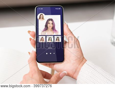 Hair Color Simulation. Woman Trying Different Hairstyles With Beauty App In Smartphone, Female Using