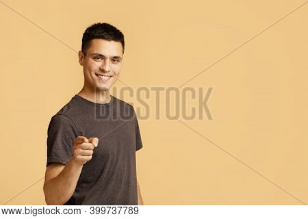 Cheerful Man In Casual Clothes Speaks Happily At You, Chooses To Compete, Has Positive Expression. H
