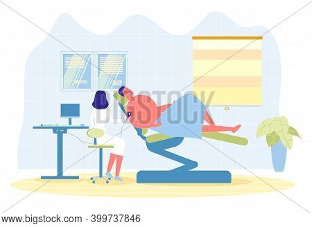 Phototherapy Session To Improve Skin Condition. Clinic Patient Sits In Comfortable Folding Chair. An