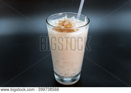 White Horchata Sweet Drink Sprinkled With Sweetness And Served In A Clear Glass With Straw To Quench