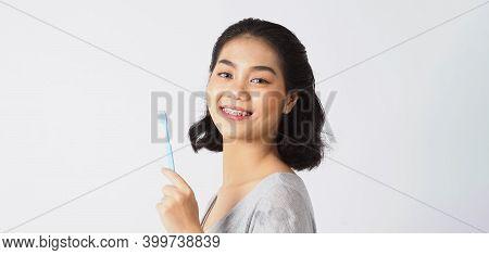 Dental Brace Teen Girl Smiling Looking On A Camera.