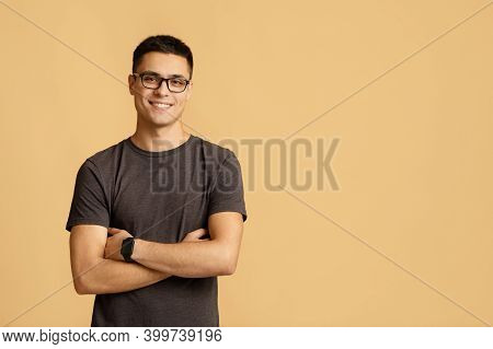 Nerd Student Blogger On Self-isolation During Lockdown. Smiling Surprised Young Man Model In Casual,