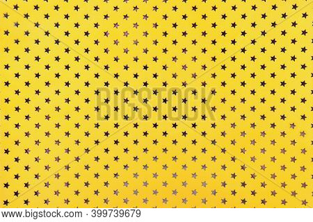 Trend Color Of The Year 2021 Illuminating Yellow. Golden Background From Metal Foil Paper With Patte