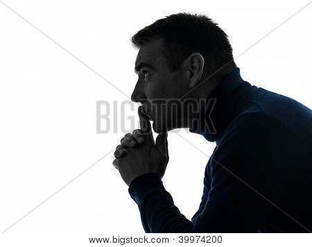 one causasian man serious thinking pensive portrait in silhouette studio isolated on white background poster