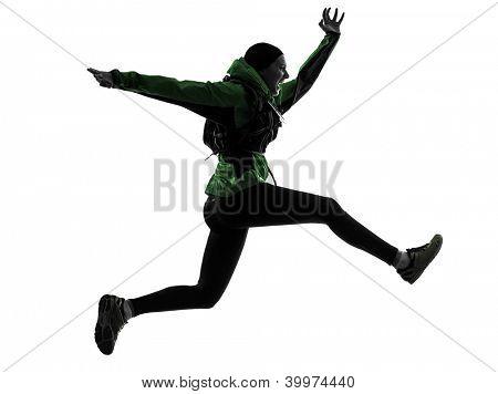 one causasian woman runner running trekking  in silhouette studio isolated on white background