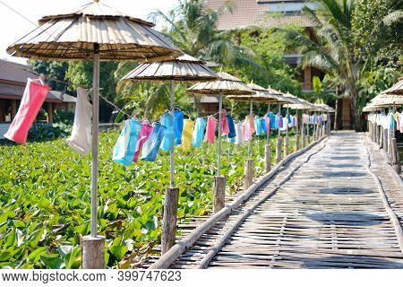 Colorful Fabric Lamp Lantern Decorating Along Wooden Bamboo Bridge Footbridge In Festival