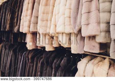 Luxury Mink Coats. Grey, Brown, Pearl Color Fur Coats On Showcase Of Market. Best Gift For Women Is