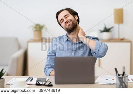 Neck Pain. Tired Businessman Massaging Aching Neck Having Health Problems After Computer Work Sittin