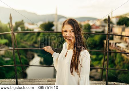 Young Woman Traveller Visiting Popular Tourist Destinations In Southeast Europe,old Bridge Landmark