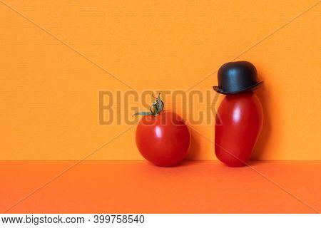 Ripe Red Mister Tomato Character Black Hat, Small Tomato On Red Orange Background. Creative Design F