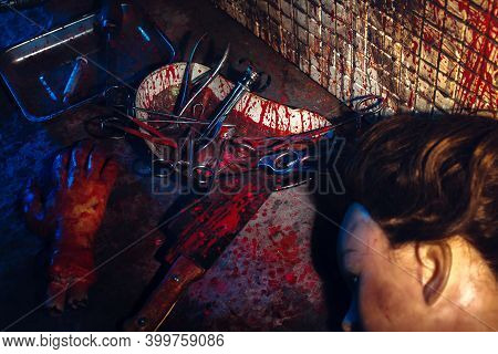 A Creepy Room With Bloodstained Walls And Medical Instruments. The Basement Of A Homicidal Maniac Wi